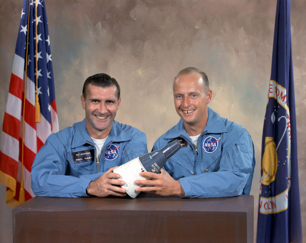 image Dick Gordon (left) and Pete Conrad pose in blue flightsuits for the Gemini 11 crew photograph - Credit: NASA