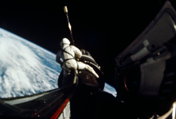 image Dick Gordon carrying out a spacewalk on Gemini 11 - Credit: NASA