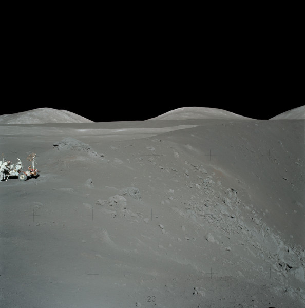 image Shorty Crater with Lunar Rover alongside. The large fractured boulder behind and to the right of the Rover is where this Moon Rock sample was collected from - Credit: NASA